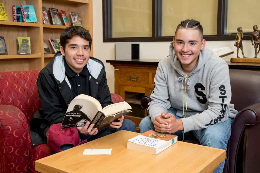Two students sitting in the library