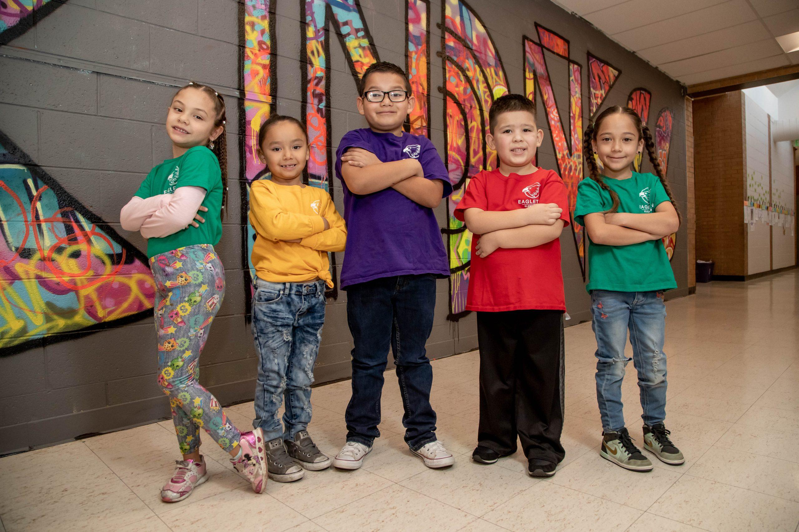 Five students in a school hallway