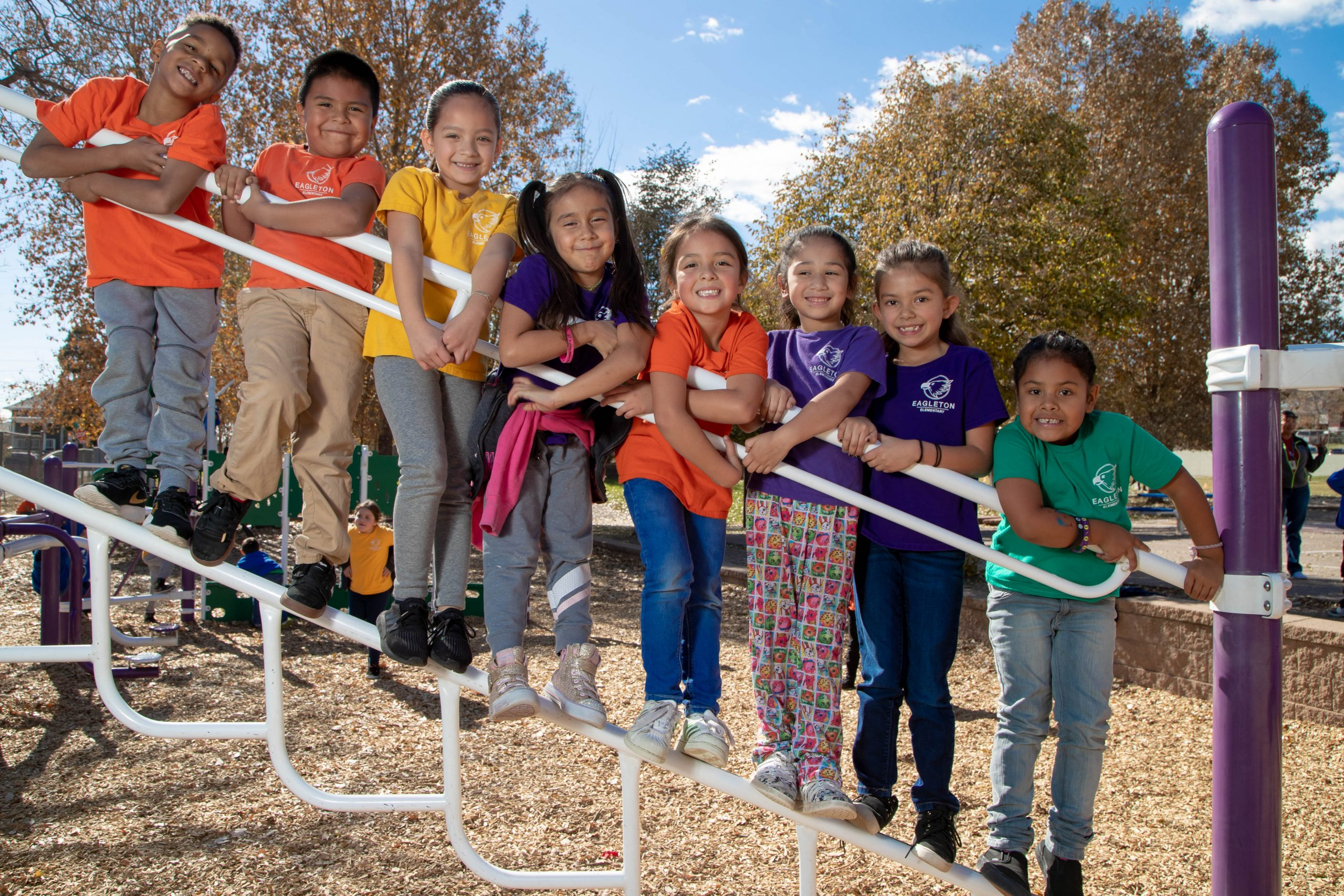 Eight students on the playground during recess