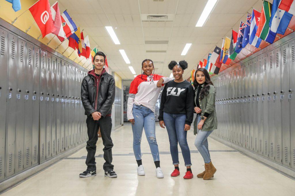 Four students in a school hallway